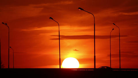 Cars silhouettes on road against sunset Stock Video Footage