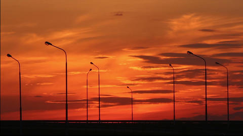 Cars silhouettes on road against sunset - timelaps Stock Video Footage