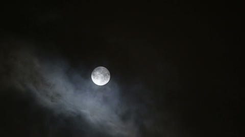 moon between clouds Stock Video Footage