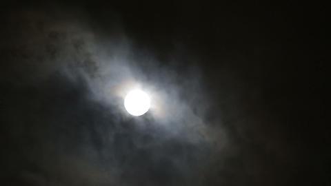 moon between clouds Stock Video Footage