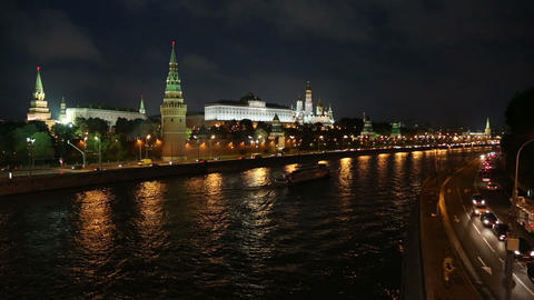 Moscow Kremlin and ship on river at night - Russia Stock Video Footage