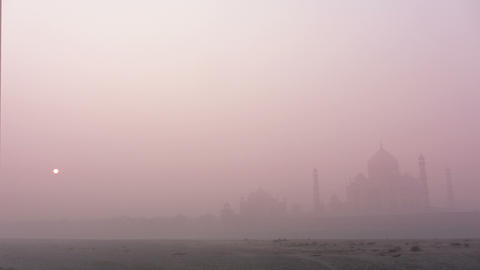 Taj Mahal at sunrise in fog - timelapse 4k Footage