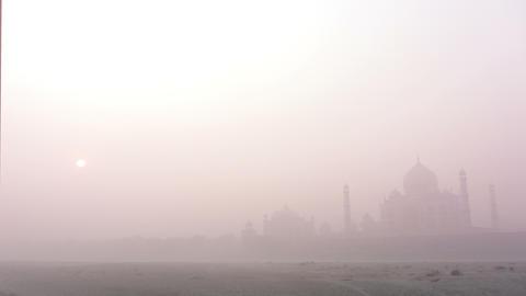 Taj Mahal at sunrise in fog - timelapse 4k Stock Video Footage