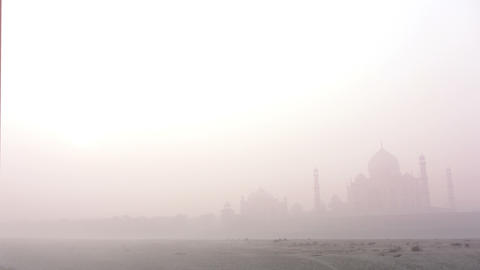Taj Mahal at sunrise in fog - timelapse 4k Stock Video Footage