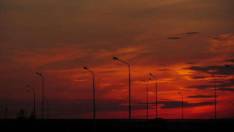 Cars silhouettes on road against sunset - timelaps Footage