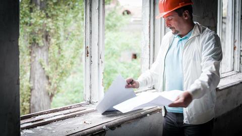 The Engineer Adjusts Working Drawings Stock Video Footage