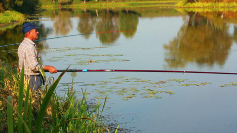 fishing senior on autumn lake Stock Video Footage