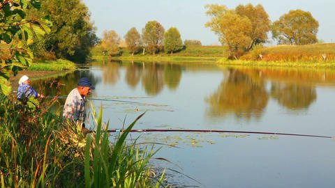 fishing senior couple on autumn lake Stock Video Footage