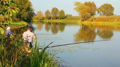 fishing senior couple on autumn lake Stock Video Footage