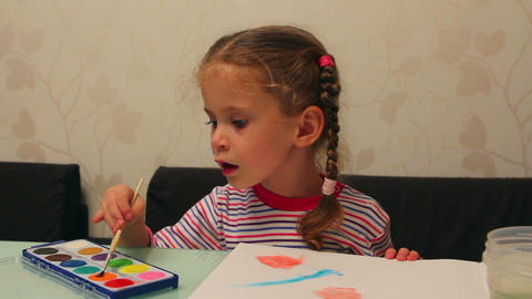 little girl draws paints - timelapse Footage