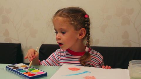 little girl draws paints - timelapse Footage