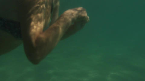 Woman bathes in the sea. Underwater View Stock Video Footage