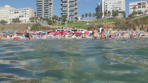 Crowded beach view from water. Underwater View Footage