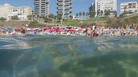 Crowded beach view from water. Underwater View Stock Video Footage