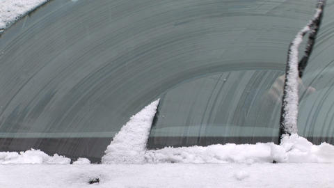 Windshield wipers clearing off the snow Stock Video Footage
