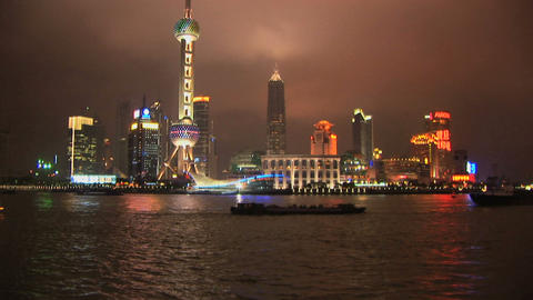 Brightly lit ship passing Shanghai, Pudong, time l Stock Video Footage