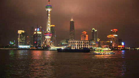 Brightly lit ship passing Shanghai, Pudong, China, time... Stock Video Footage