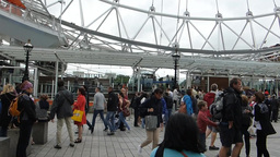 London Eye barding station filled with large group of visitors, London, UK Footage
