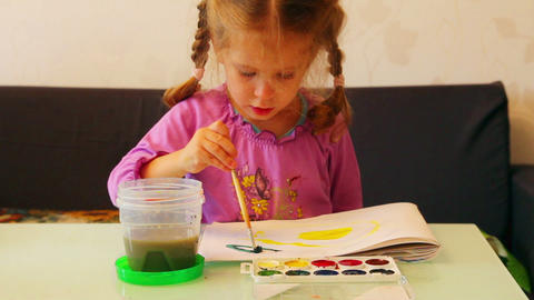 little girl draws paints Stock Video Footage
