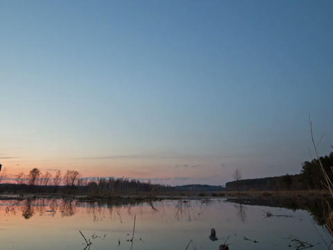 Sunset and starry sky reflected in lake. Time Laps Stock Video Footage