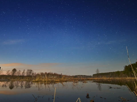 Sunset and starry sky reflected in lake. Time Laps Footage