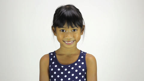 Confident Little Asian Girl Smiles At Camera Stock Video Footage
