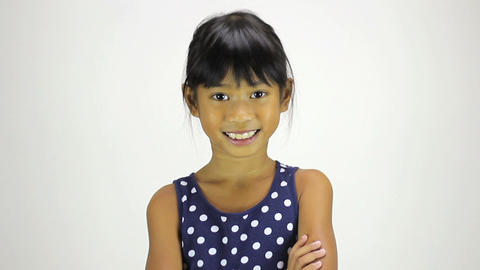 Confident Little Asian Girl Smiles At Camera Footage