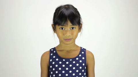 Cute Little Asian Girl Smiling At Camera Stock Video Footage