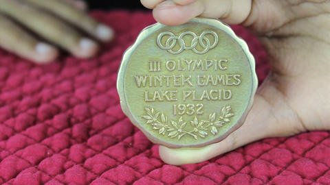 Girl Holds Olympic Gold Medal Stock Video Footage