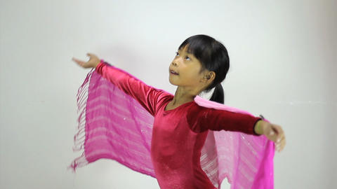 Little Asian Girl Does A Creative Dance Side View Footage