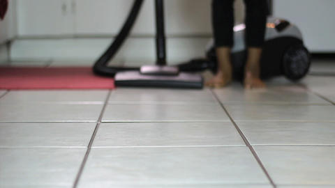 Little Girl Vacuuming Kitchen Floor Low Angle Stock Video Footage