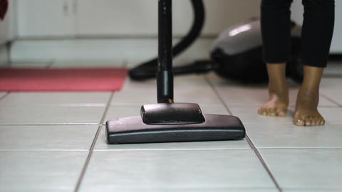 Little Girl Vacuuming Kitchen Floor Low Angle stock footage
