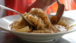 Eating A Plate Of Mee Siam. (EATING MEESIAM--1B) stock footage