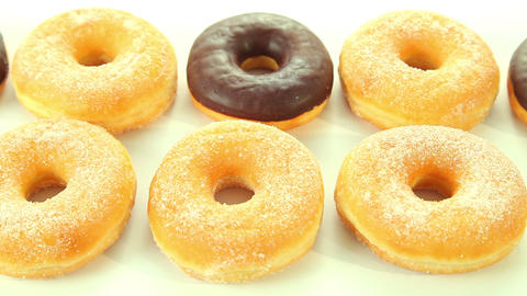 Chocolate donuts on white background Footage