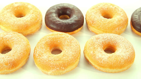 Chocolate donuts on white background Stock Video Footage
