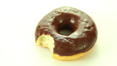 Chocolate donut on white background Stock Video Footage