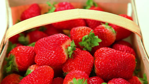 Beautiful ripe red strawberries in basket Footage