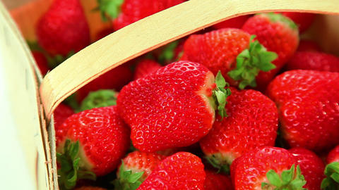 Beautiful red strawberries in basket Footage