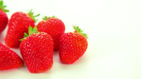 Beautiful red strawberries on white background Stock Video Footage