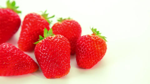 Beautiful red strawberries on white background Footage