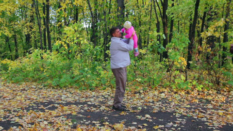 father playing with baby in autumn park Footage
