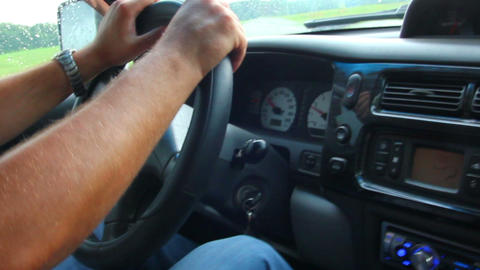 man's hand driving in car close-up Stock Video Footage