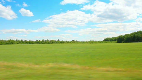 driving along green field at summer Footage