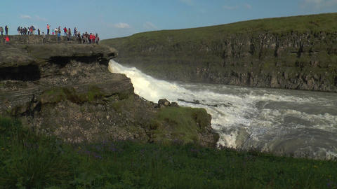 gullfoss waterfall in iceland tourists on viewing Stock Video Footage