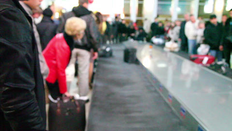 Passengers waiting for their luggage (no focus) Stock Video Footage
