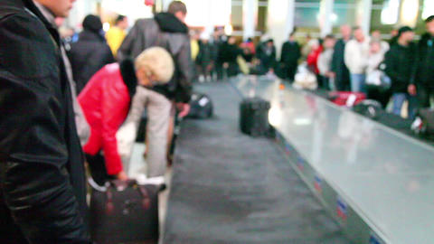 Passengers waiting for their luggage (no focus) Footage