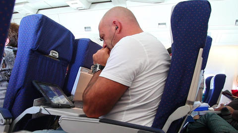Man with tablet computer sitting in the plane Footage