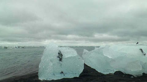 isolated icebergs on lava beach at jökulsarlon gl Stock Video Footage