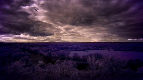 InfraRed landscape: Movement of clouds over the ri Stock Video Footage