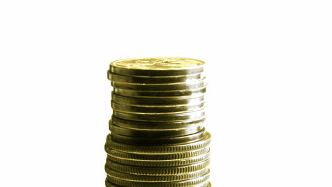 growing stack of coins isolated on white, then dec Stock Video Footage